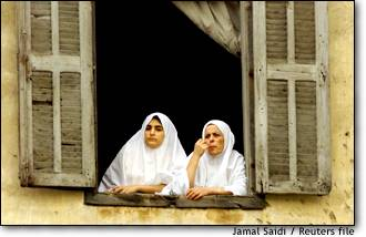 Image: Lebanese Sunni Muslim Women Watch Rally In Tripoli